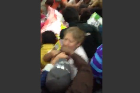 Black Friday Chaos: Crazed Shoppers Mob a Product Display and Fellow Shoppers at Walmart